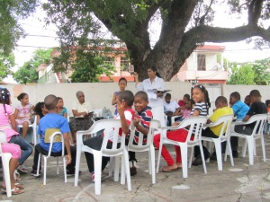 Sunday School class meeting under the tree.